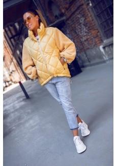 Куртка с вязанными рукавами в желтом цвете